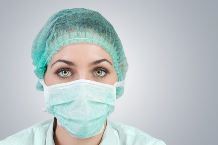 surgent: Portrait of female a medical professional surgeon.  Stock Photo