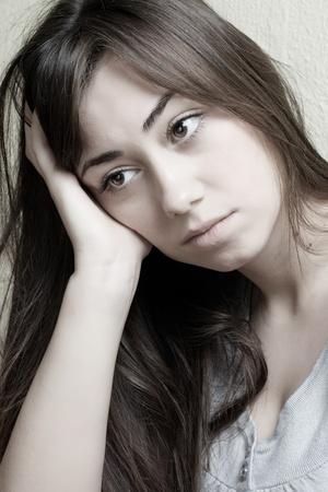 Closeup portrait of depressed teenager girl. photo