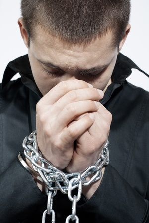 Man with a chained hands. Stock Photo - 8658517