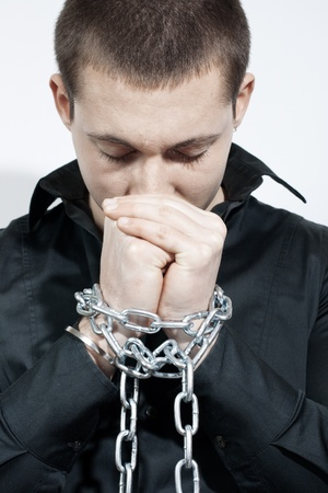 Man with a chained hands. Stock Photo - 8658514