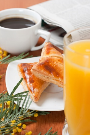 Continental breakfast served with coffee and orange juice. photo