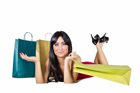 Shopping woman with bags isolated on white. photo