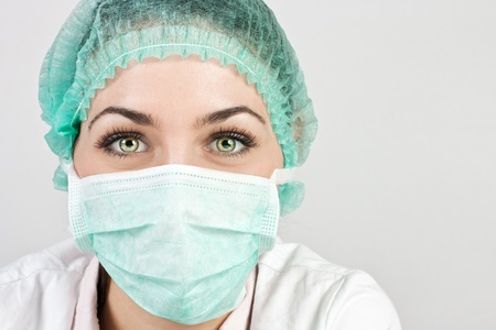 doctor with mask: Portrait of female a medical professional surgeon.  Stock Photo