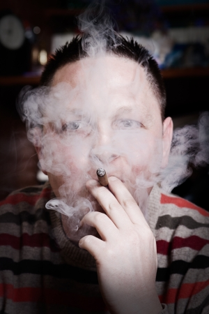 Close up portrait of man smoking cigar. photo