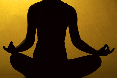 Silhouette of woman body in yoga pose. photo