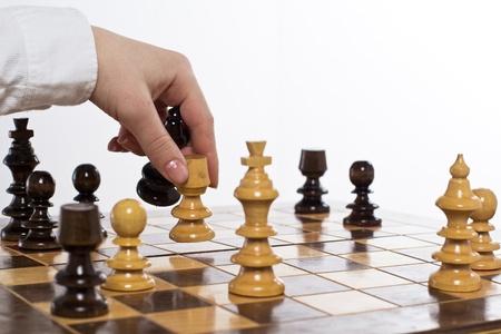 Human hand move chess figure at chessboard. Standard-Bild