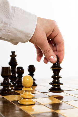 hand move: Human hand move black king on chessboard. Stock Photo