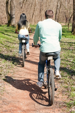 Couple on bike relaxing outdoors. photo
