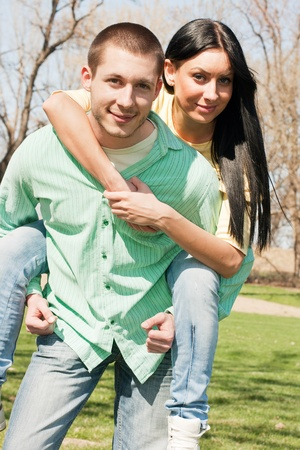 Young couple fun outdoors on sunny day. photo