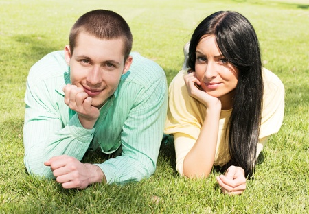 Young couple relaxing outdoors happiness. photo