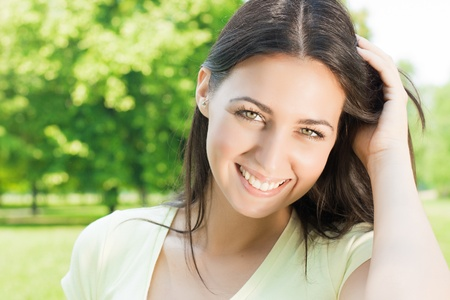 Happiness beautiful young woman outdoor portrait. Stock Photo - 9666910