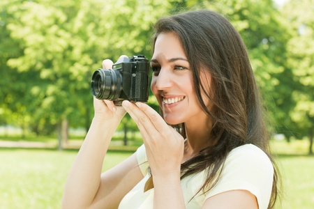 photo shooting: Girl photographer with old fashioned camera. Stock Photo
