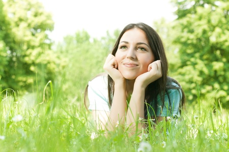 Charming girl relaxing on green grass. Stock Photo - 9666236