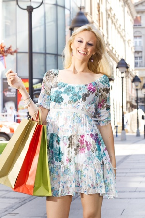Attractive shopping woman with bags. Stock Photo - 9667191