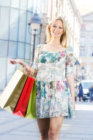 Attractive shopping girl with bags. Stock Photo - 9667194