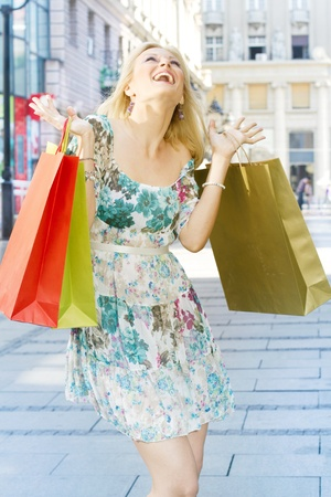 pleasures: Attractive shopping woman with bags. Stock Photo
