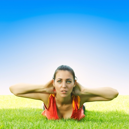Active young women doing stretching exercise outdoors. Stock Photo - 9859350