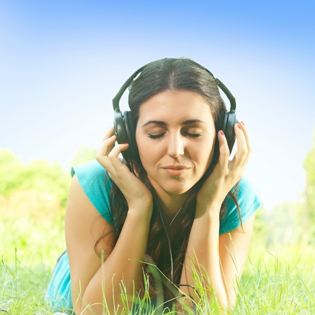 Relaxed girl with headphones listen the sounds of nature. Stock Photo