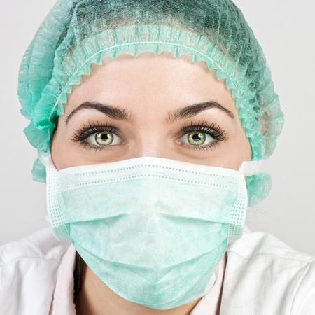 surgent: Portrait of female a medical professional surgeon.