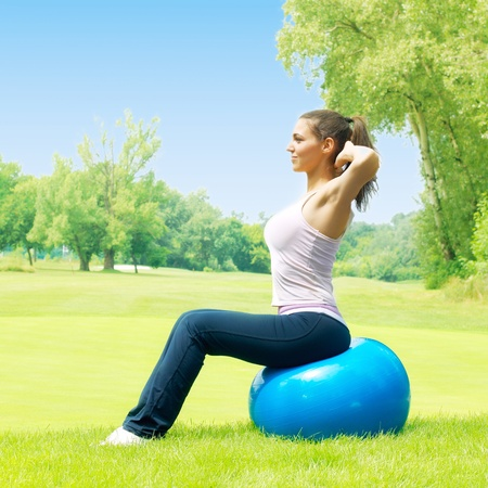 Fitness women exercising with pilates ball outdoors. Stock Photo - 10000224