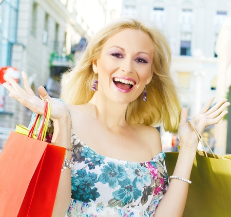 Excited shopping woman with bags. photo