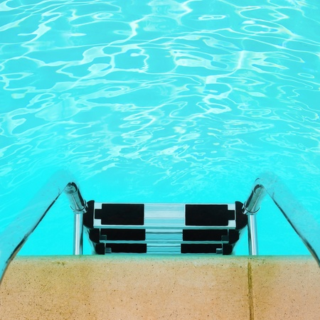 Swimming pool ladder with copyspace. photo