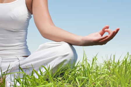 meditation woman: Closeup of woman hands in yoga meditation pose outdoors. Stock Photo