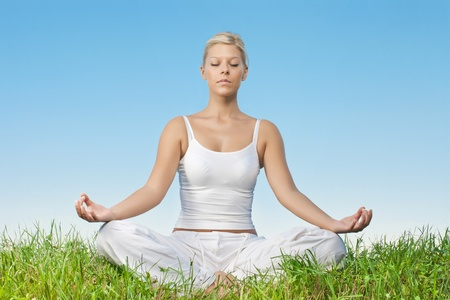 Portrait of relaxed young woman meditating outdoors. photo