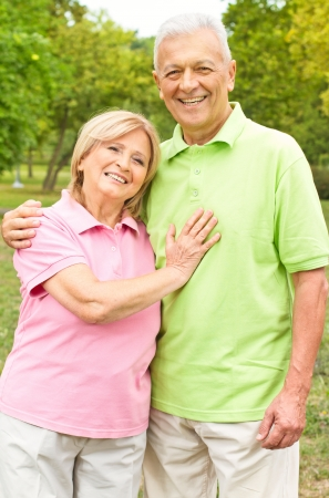 older age: Portrait of a happy senior couple in the park. Stock Photo