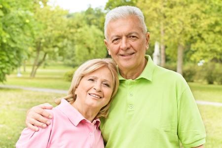 Portrait of romantic elderly couple outdoors. Stock Photo - 10570380