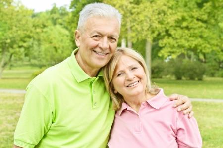 Romantic elderly couple in the park.
