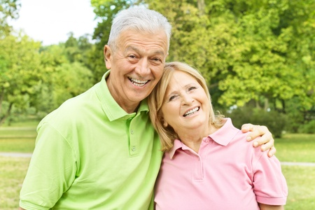 Portrait of a happy elderly couple outdoors. Stock Photo - 10570394