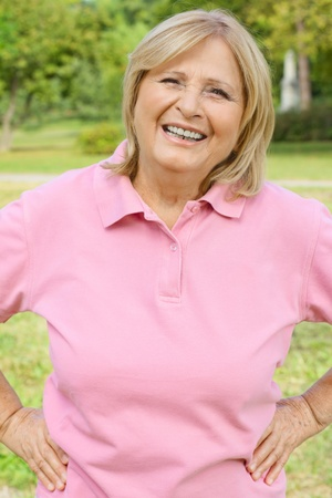older women: Portrait of successful senior woman outdoors. Stock Photo