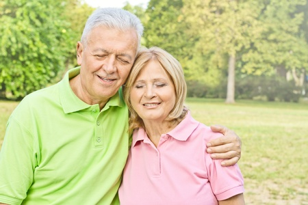 Happy senior couple enjoying nature with closed eyes. Stock Photo - 10570383