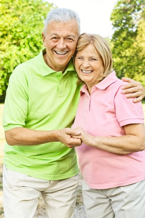 Portrait of happy old people looking at camera. Stock Photo - 10570384