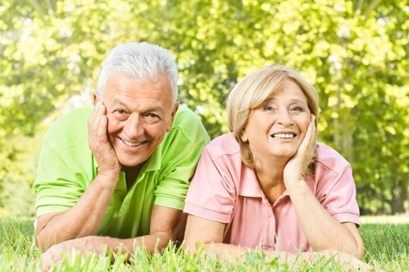 retirement  age: Portrait of happy old people relaxed in nature.