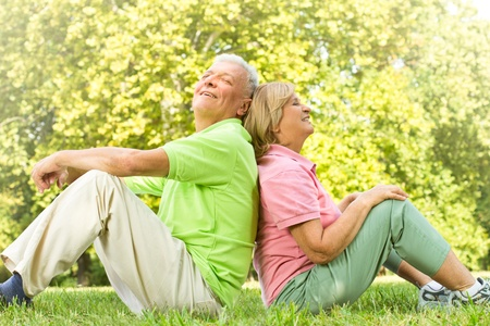 Portrait of happy old people relaxed in nature back to back. Stock Photo - 10612960
