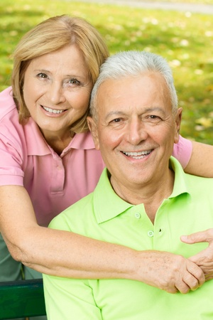 Closeup portrait of happy mature woman embracing elderly man. photo