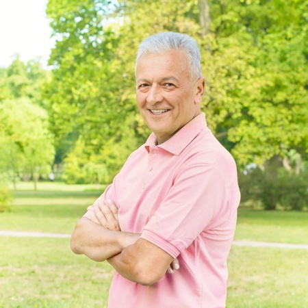 Portrait of smiling old man in the park.