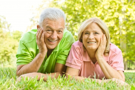 Portrait of happy old people relaxed in nature. photo