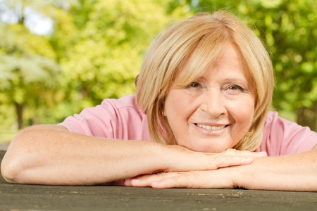 Portrait of smiling senior woman outdoors.