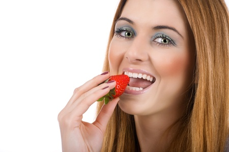 Happiness young woman eating fresh strawberry. photo