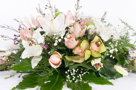 floral arrangement: Flower bouquet against white background. Stock Photo