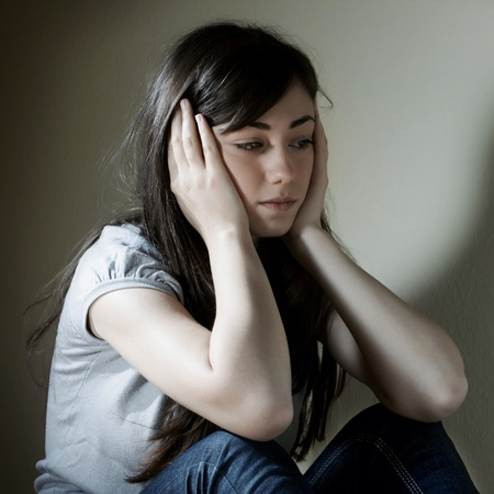 Portrait of depressed teenage girl .