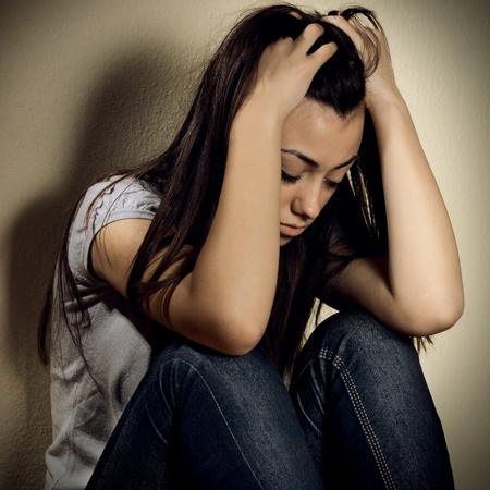 Portrait of depressed teenage girl with hand over head. Stock Photo - 12323147