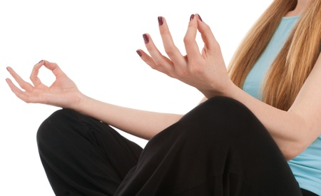 Closeup of woman hands during meditation over white background. photo