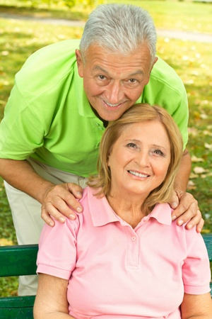 Happy senior woman and man enjoying in the park. photo
