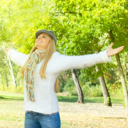 Happiness woman with raised hands enjoying in the nature  photo