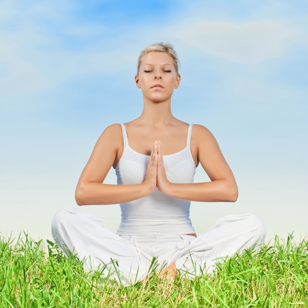 Beautiful young woman doing yoga meditation outdoors  photo