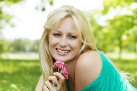 Portrait of beautiful and smiling blond woman relaxing in the park Stock Photo - 12893185